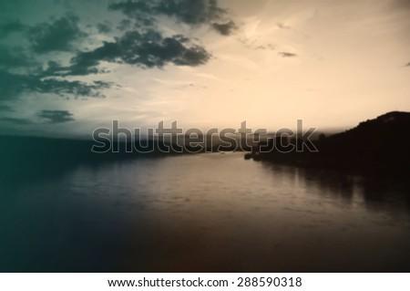 Blurred vintage background of sunset on the Danube River in Bratislava, Slovakia - stock photo