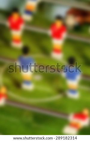 Blurred Vintage Foosball, Blue and Red Players Team Out of Focus in Table Soccer or Football Kicker Game, Out of Focus, Retro Tone Effect - stock photo