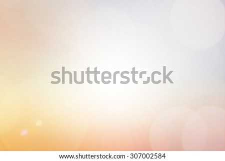 Blurred vivid warm bright background of sunrise time hour landscape with lens lights.abstract bright golden hour dusk backdrop:sunshine shiny sparkle illuminated sun rays color orange gradient display - stock photo
