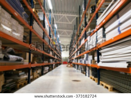 Blurred warehouse storage racks. Suitable for background. - stock photo