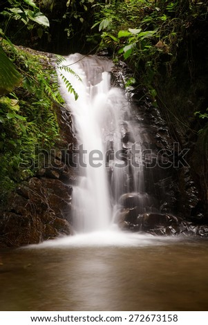 Blurred waterfall in the cloudforest near Mindo, Ecuador - stock photo