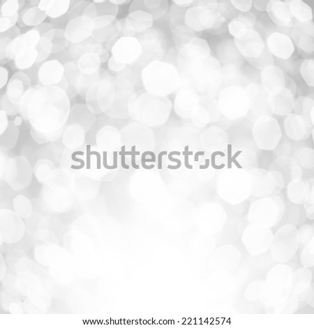 Blurred white and silver sparkles - stock photo