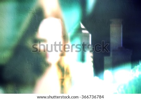 Blurred young business woman working in the office. City skyline in the background. - stock photo