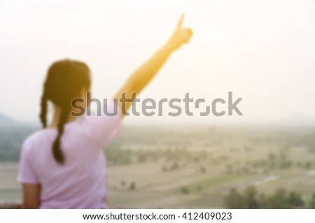 blurred young girl on top view with sunlight