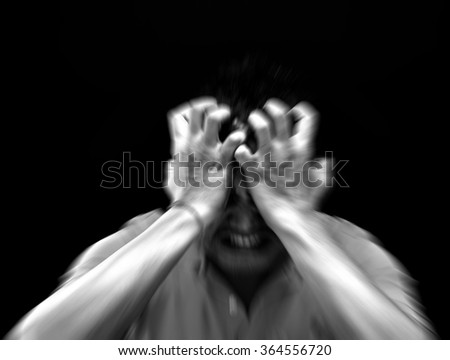 Blurred zoom of Anxious  asian short hair man feeling sadness and stress, Black and white abstract style - stock photo