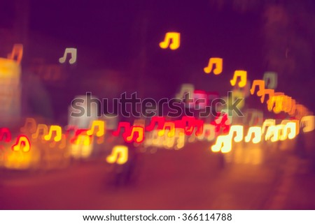 Blurring lights bokeh background of music notes - stock photo