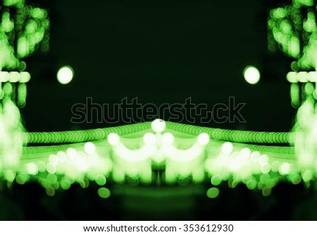Blurring the pattern of light is beautiful bokeh./Blurry natural green light  beautiful background and texture. - stock photo