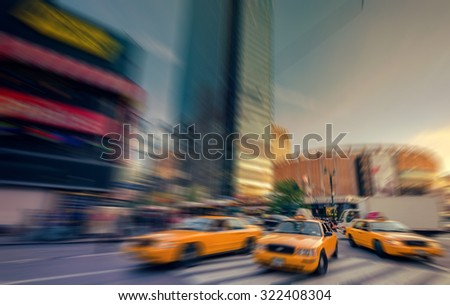 Blurry abstract photo in a city with people and vehicles - stock photo