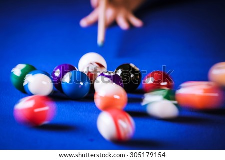 blurry and moving of billiard balls in a blue pool table - stock photo