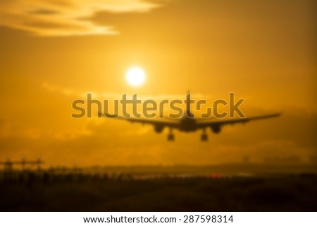 Blurry background from a plane landing at sunrise. - stock photo