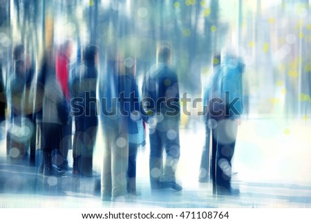 blurry background image of people waiting on busy street