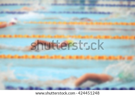 blurry background of student swimming race
