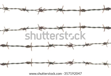 Blurry barbed wire on white background