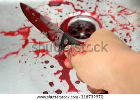 Blurry bloody and hand hold knife in sink with flowing red blood. Murder and halloween concept background - stock photo