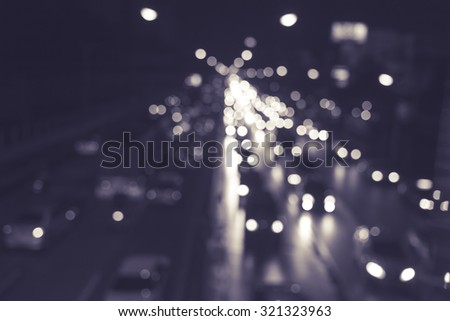 Blurry bokeh of traffic light at night color in black and white