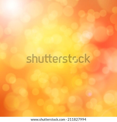Blurry bokeh on yellow and red background with flare effect.  - stock photo