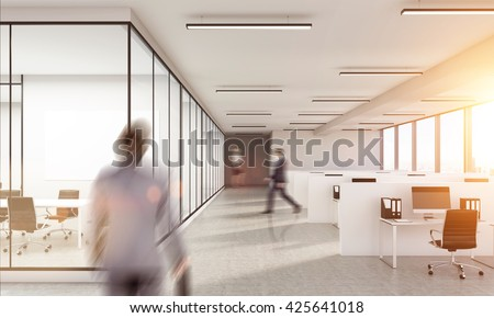 Blurry business man walking inwhite  office interior with sunlight. Woman on background. Law office.  - stock photo