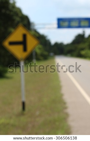 blurry crossroad sign - stock photo