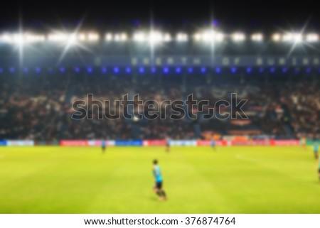 Blurry de-focused stadium football  twilight background. - stock photo