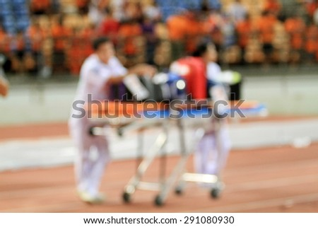 blurry Doctor stand by with Stretcher and hospital trolley for help - stock photo