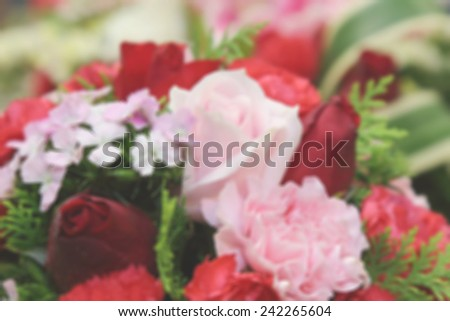 blurry flowers bouquet with pink and red roses - stock photo