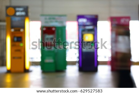 Blurry focus on Automatic Teller Machine or ATM in Bank and financial concept