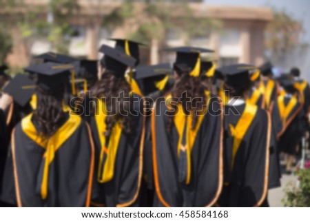 Blurry Graduates are walking in line to get your degree, - stock photo