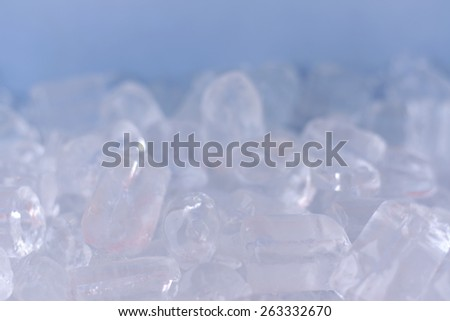 blurry ice cubes on blue background - stock photo
