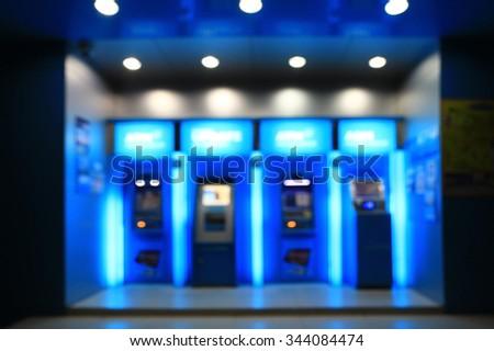 blurry image of cash machine on a night - stock photo