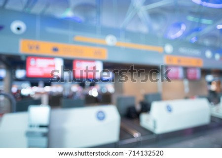 Blurry image of check in counter in airport