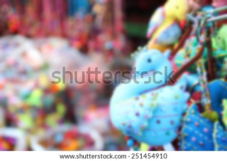 blurry image of colorful handmade souvenir key chain selling at the market