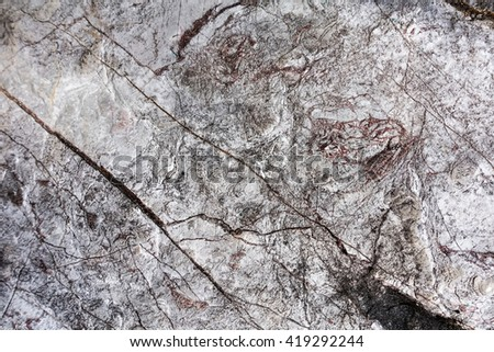 blurry image of natural stone patterned textures background. Limestone.  - stock photo