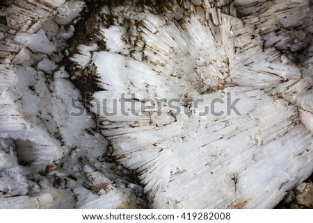 blurry image of natural stone patterned textures background. Mineral Calcite. - stock photo