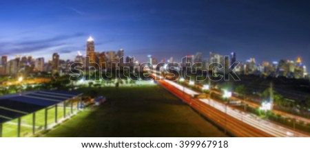 Blurry image of Road through the Bangkok city business area in the evening blue sky, tilt-shift effect background - stock photo