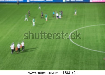 blurry injured player in football match
