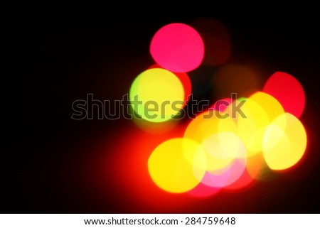 Blurry light effect and bokeh from small size of multicolor lightbulb on dark background represent the abstract concept related idea. - stock photo
