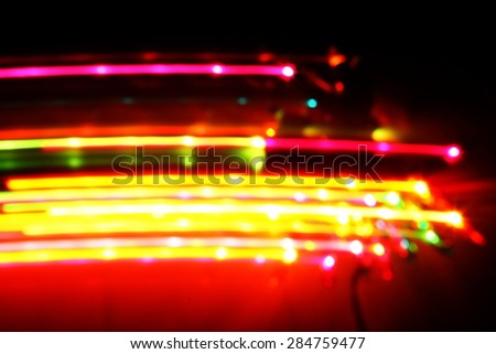 Blurry light effect from small size of multicolor lightbulb on dark background represent the abstract concept related idea.