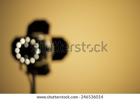 Blurry location spot light, small lamp and wall - stock photo