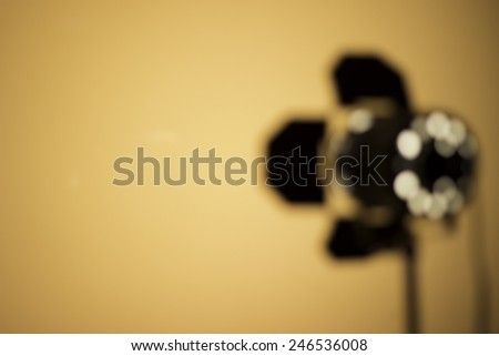 Blurry location spot light, small side lamp and wall - stock photo
