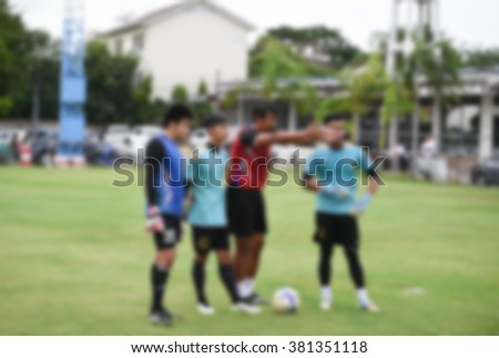 blurry,motion blur,Coach goalkeeper in action training football,defend (soccer) - stock photo
