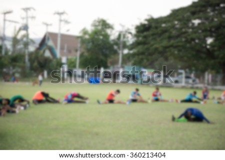 blurry,motion blur,Goalkeeper in action playing football,Stretching (soccer) - stock photo
