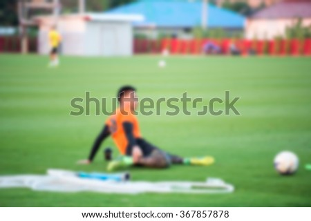 blurry,motion blur,Players in action playing football,Stretching (soccer) - stock photo