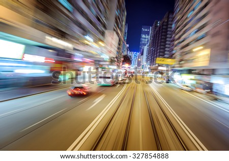 Blurry motion effect night city view from car perspective in Hong Kong downtown  - stock photo