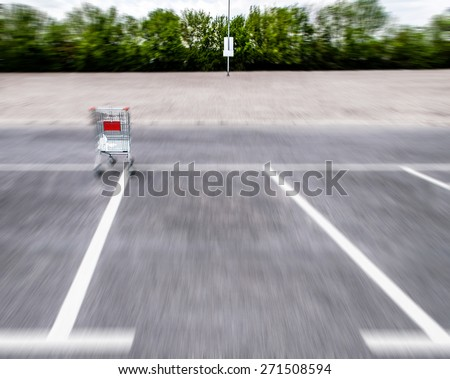Blurry motion shopping carts on a empty parking lot - stock photo