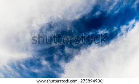 Blurry of cloud and sky background in the pastel vintage  style. - stock photo