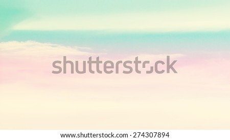 blurry of cloud background with a pastel colored orange to blue gradient. - stock photo