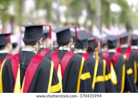 blurry of Graduates are walking the line to get a diploma and selective focus.