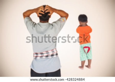 blurry of little asian boy angry his father - stock photo