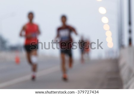 Blurry of marathon runners on the road. - stock photo