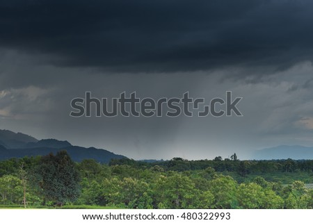 Blurry of rain storm over the mountain.